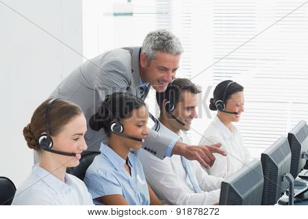 Manager checking his colleagues works in office