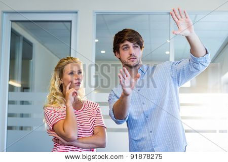 Handsome businessman doing frame with his hands and showing to his partner in the office