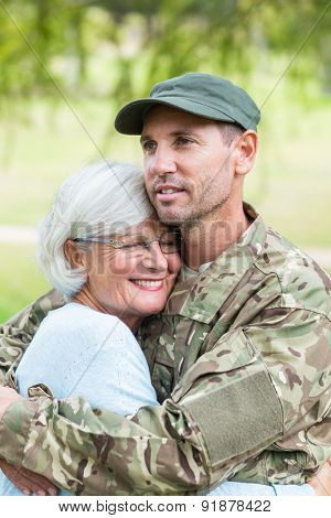 Soldier reunited with his mother on a sunny day