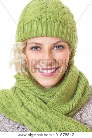 Portrait Of A Beauty Woman Wearing Warm Sweater With Wool Scarf And Cap, Isolated On White Backgroun