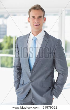 Businessman smiling at the camera in the office