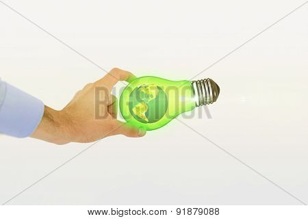 Businessman holding hand out in presentation against earth