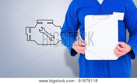 Male mechanic holding clipboard against grey vignette