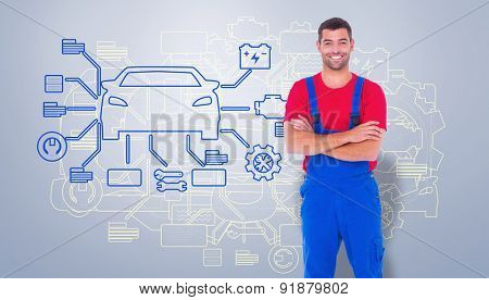 Handyman in overalls standing arms crossed over white backgound against grey vignette