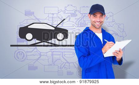 Portrait of happy male mechanic writing on clipboard against grey vignette