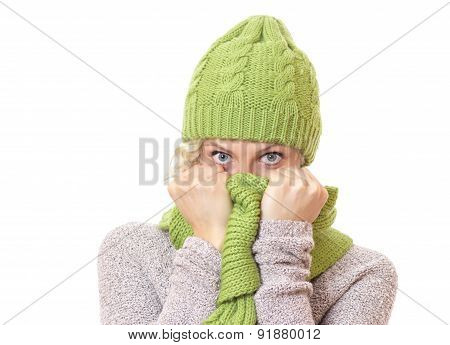Funny  Woman Wearing Warm Sweater With Wool Scarf And Cap, Isolated On White Background. Girl Lookin