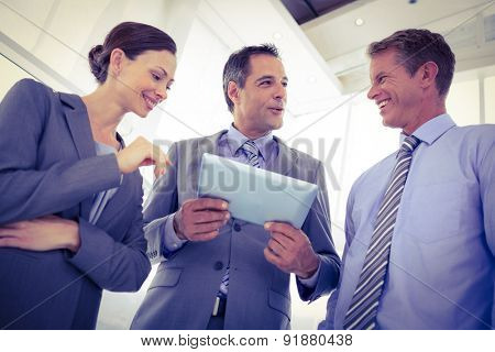 Business team using tablet together in the office