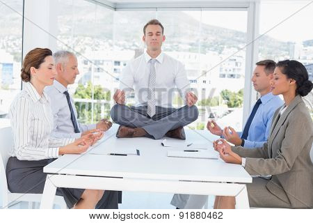Business team relaxing eyes closed in the office