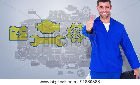 Mechanic with tire gesturing thumbs up against grey vignette