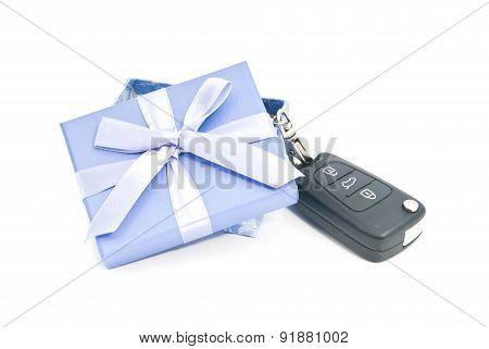 Gift Box And Car Keys On White