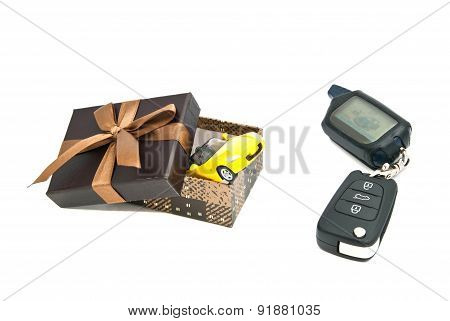 Yellow Car, Keys And Brown Gift Box
