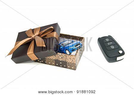 Blue Car, Keys And Brown Gift Box