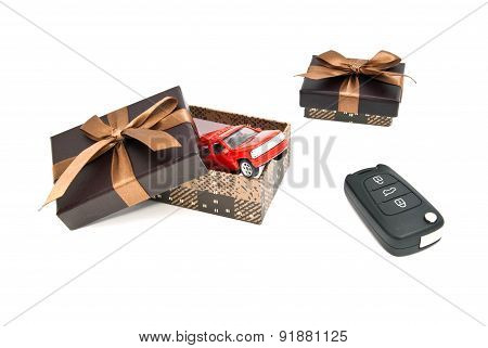 Red Car, Keys And Brown Gift Boxes