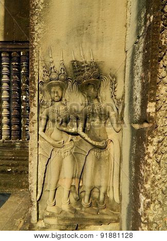 Elegant frescoes and bas-reliefs of apsaras in the temple of Angkor.Cambodia