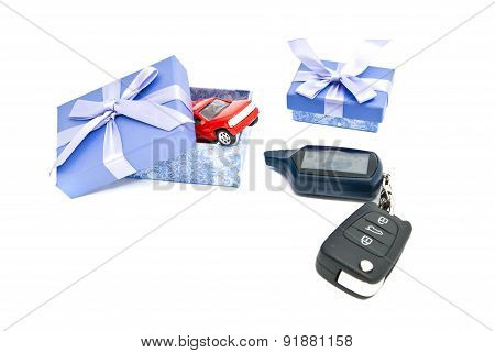 Red Car, Keys And Blue Gift Boxes On White