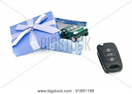 Keys, Green Car And Blue Gift Box
