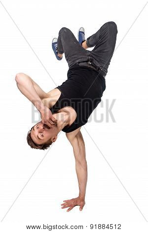Break dancer doing one handed handstand against a white background