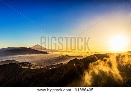 Sun With Clouds Over Mountain