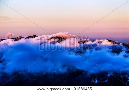 Landscape With Pink Clouds Over Mountain