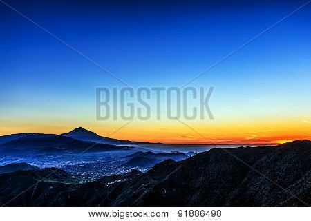 Sunset In Mountains And Sky With Fog