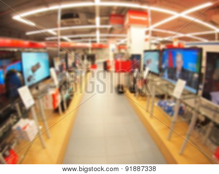 Defocused And Blur Image Of A Shop Selling Tvs