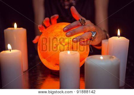 Fortune teller forecasting the future on black background