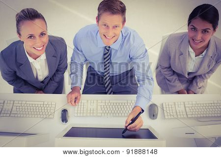 Businessman showing his screen to the team in office