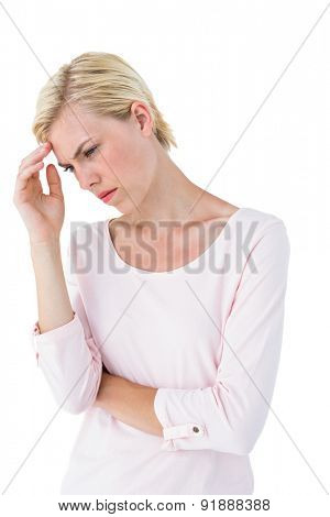 Thoughtful blonde woman on white background