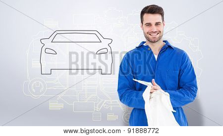 Male mechanic wiping hands with cloth against grey vignette