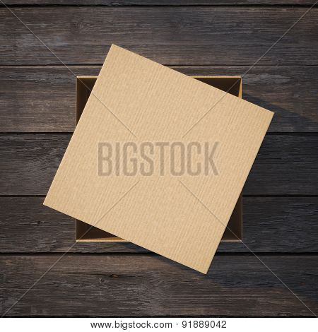 Cardboard box with a cap