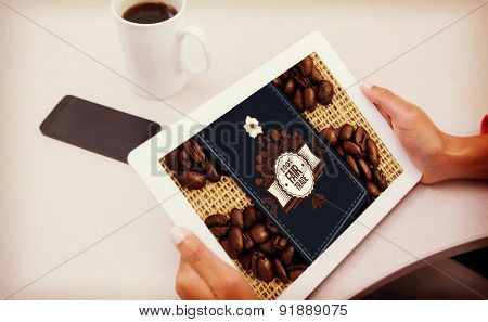 Woman using tablet pc against fair trade label on coffee