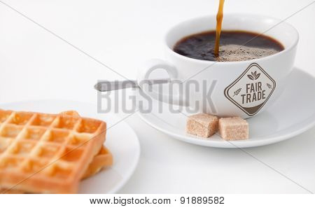 Fair Trade graphic against waffles sugar and a cup of coffee on white plate