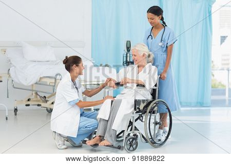 doctors and patient in wheelchair at the hospital
