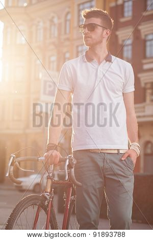 Stylish Biker With Vintage Race Bike