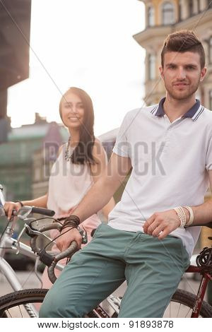 Happy Couple On Bikes