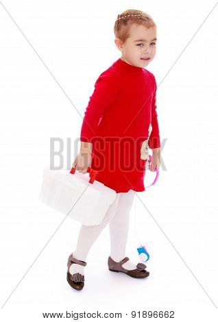 Cute little girl with medical briefcase in his hand