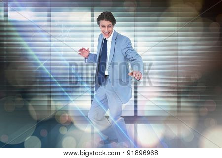 Smiling businessman against window overlooking city