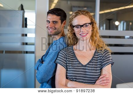 Portrait of smiling partners posing together in the office