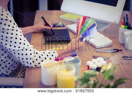 Interior designer working at desk in creative office