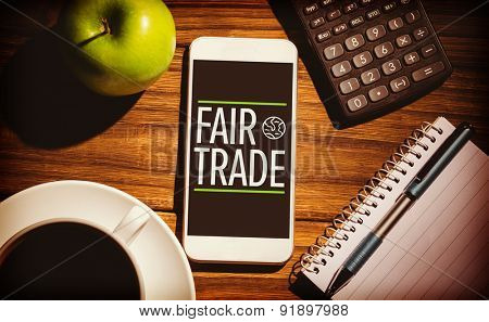 fair trade against smartphone on table