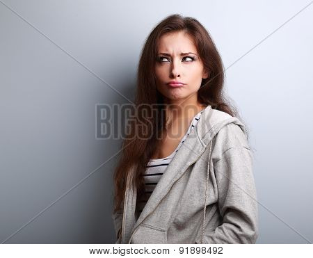 Grimacing Fun Young Woman Thinking And Looking Fun