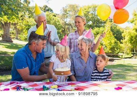 Happy family celebrating a birthday on a sunny day