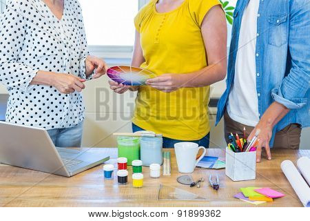 Casual business team discussing about colour chart in the office
