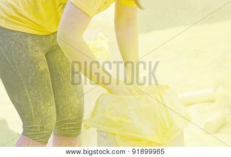 One Of The Official Woman Collecting Yellow Color Powder