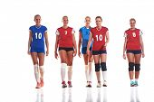 picture of indoor games  - volleyball game sport with group of young beautiful  girls indoor in sport arena ball net - JPG