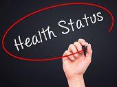picture of status  - Man hand writing Health Status on visual screen - JPG