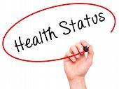 pic of status  - Man hand writing Health Status on visual screen - JPG