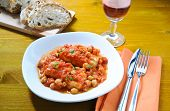 stock photo of cod  - Salt cod with chickpeas and tomatoes Roman - JPG