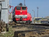 foto of chug  - A moving freight train through station in the small city - JPG