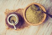 stock photo of mating  - Vintage photo of traditional yerba mate tea popular in latin america